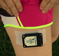 The Moxy Monitor on the thigh of a runner. It is tough enough for use on the rugby field.
